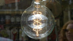 Beautiful big spheric electric bulb. Concept energy consumption lamp detail stock footage