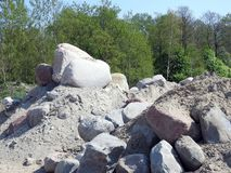 Beautiful big stones near trees, Lithuania. Big different shape and colors stones near trees, can use as background royalty free stock images