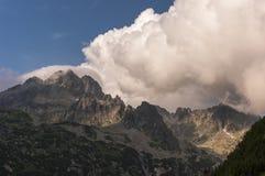 Beautiful big white clouds over mountain peaks. Tatry. Slovakia.  Stock Image