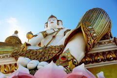 Beautiful Big white color of Molding Brahma on lotus flowers groundwork in daylight. With Blue Sky Background in Thai Famous Temple from Thailand Royalty Free Stock Photography