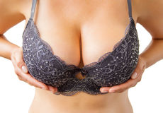 Beautiful big woman's breasts in black bra Stock Photo