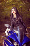Beautiful Biker girl on a motorcycle Stock Photography