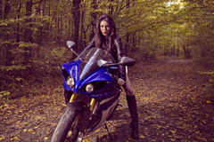 Beautiful Biker girl on a motorcycle Royalty Free Stock Photo