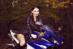 Beautiful Biker girl on a motorcycle Royalty Free Stock Photography