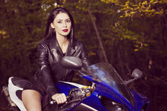 Beautiful Biker girl on a motorcycle Royalty Free Stock Images