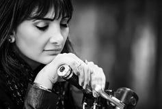 Beautiful biker woman royalty free stock image