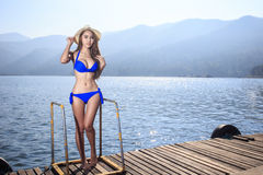 The beautiful bikini model on the Lake Royalty Free Stock Photography
