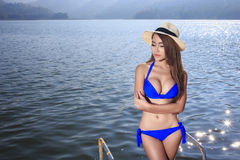 The beautiful bikini model on the Lake Stock Photo