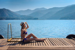 The beautiful bikini model on the Lake Stock Image