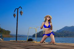The beautiful bikini model on the Lake Stock Photography