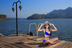 The beautiful bikini model on the Lake Stock Images