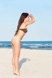 Beautiful bikini model posing on the beach Stock Photography