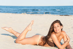 Beautiful bikini model posing on the beach Royalty Free Stock Images