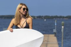 Free Beautiful Bikini Model Relaxing On A Paddle Board Royalty Free Stock Photography - 159871067