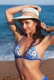 Beautiful bikini woman with epilation armpit on blue sea background Stock Image