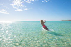 Beautiful bikini woman jumping in tropical sea Royalty Free Stock Photos