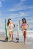 Beautiful Bikini Women Surfers & Surfboards At Beach Stock Image