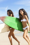 Beautiful Bikini Women Surfers & Surfboards At Beach Stock Photo