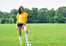 Beautiful biracial female soccer player. Stunning young biracial (African American and Caucasian) woman soccer player smiling in yellow mesh practice jersey (bib royalty free stock image
