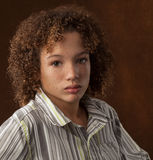 Beautiful Biracial Preteen Boy. A portrait of a preteen boy with curly hair, freckles, and green eyes Stock Photos