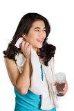 Beautiful biracial teenage girl drinking water while wiping off Stock Photography