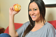Beautiful biracial woman eating an apple Royalty Free Stock Images