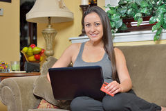 Beautiful Biracial woman using laptop computer - shopping Royalty Free Stock Photo