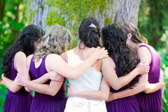 Beautiful biracial young bride with her multiethnic group of bri Stock Images