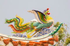 A beautiful bird on the roof of the shrine in Thailand. The beautiful bird on the roof of the shrine in Thailand stock image