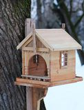 Beautiful birdhouse in winter on a tree royalty free stock images