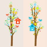 Beautiful birds and birdhouses on trees Stock Photo