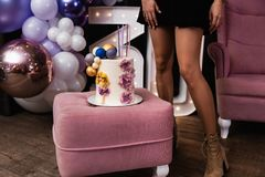 Hot sexy long legs - Beautiful birthday cake at a party - 30th Anniversary royalty free stock image