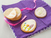 Beautiful biscuits in the shape of easter egg. Easter sugar cookies with floral ornament. Stock Image
