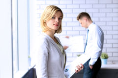 Beautiful bisness woman. business colleagues analyzing financial figures on a graphs Stock Images