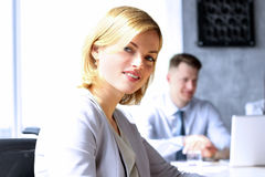 Beautiful bisness woman. business colleagues analyzing financial figures on a laptop Stock Photo