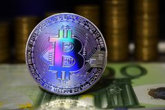 Beautiful Bitcoin BTC on the background of euro banknote and gold coins. The concept of cryptocurrency royalty free stock images