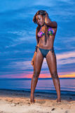 Beautiful black African American woman posing on the beach  Royalty Free Stock Photography