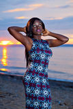 Beautiful black African American woman posing on the beach at su Stock Photo