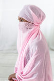 Beautiful  black african muslim woman wearing pink headscarf Stock Images