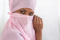 Beautiful  black african muslim woman wearing pink headscarf Royalty Free Stock Photos