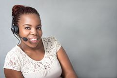 Beautiful black call center agent talking client Royalty Free Stock Images