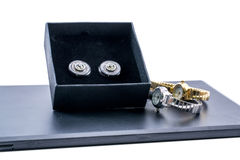 Beautiful black earrings in a box and two watches Royalty Free Stock Photos
