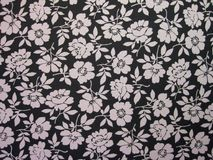 Beautiful black fabric with flowers Royalty Free Stock Photo