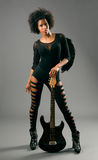Beautiful black girl with angel wings and electric guitar Stock Photography
