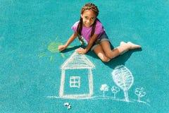 Beautiful black girl draw with chalk Stock Image