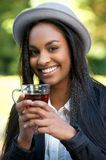 Beautiful Black Girl Drinking Tea Outdoors. Beautiful Black Girl Drinking Tea at an Outdoors Cafe Stock Images