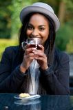 Beautiful Black Girl Smiling and Drinking Tea Royalty Free Stock Photos