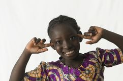 Beautiful black girl smiling and thinking isolated on white. Beautiful shot of African children taken in a studio in Bamako, Mali Stock Images