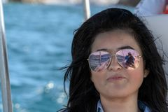 Black hair mexican latina girl portrait with sunglasses royalty free stock image
