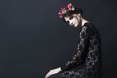 Beautiful woman with flower rim on head in lace dress Stock Photos